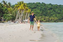 Dad plays with his son in the sea.  royalty free stock photo