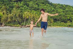 Dad plays with his son in the sea.  royalty free stock photos
