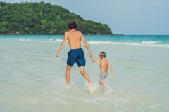 Dad plays with his son in the sea.  royalty free stock photography