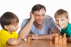 Dad plays with sons. Portrait of a dad playing with sons royalty free stock photos