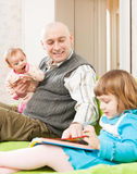 Dad plays with two daughters Royalty Free Stock Photo
