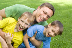 Dad Plays With Young Children Royalty Free Stock Images