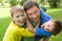 Dad plays with young children Stock Photos