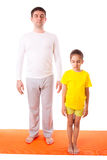 Dad practicing yoga with daughter isolated Royalty Free Stock Photo