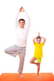 Dad practicing yoga with daughter isolated Stock Photo