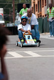 Dad Pushes Daughter In Atlanta Soap Box Derby Race stock photography