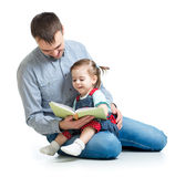 Dad reading a book to kid Stock Image
