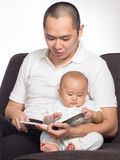 Reading book with dad Stock Images