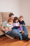 Dad reading story to kids royalty free stock photo