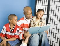 Dad reading to his kids Stock Photography