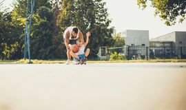 Dad, this is a real fun. Father and son playing on playground stock photos