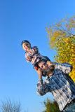 Dad rolls the child's neck Royalty Free Stock Photography