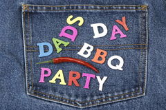 Dad's Day BBQ Party Wood Sign On Blue Jeans Pocket Royalty Free Stock Images