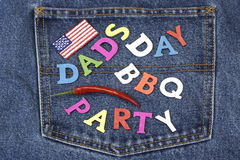 Dad's Day BBQ Party Wood Sign On Blue Jeans Pocket Royalty Free Stock Photography