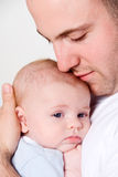 Dad's love. Dad holing and caressing his baby boy