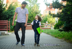 Dad's taking a first grader to school. Royalty Free Stock Photos