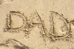 Dad in sand. The word Dad written in sand on the shore of Waikiki beach Royalty Free Stock Photography