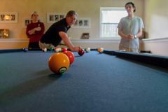 Free Dad Shooting Pool With His Sons Stock Image - 119454641