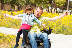 Dad  showing freedom with his little daughter. Stock Photos