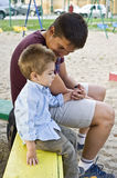 Dad and son. Portrait with dad talking to his son on a bench Stock Photo