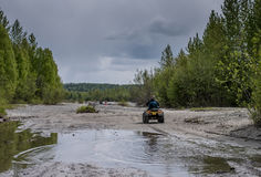 Dad and Son on ATV royalty free stock image