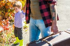 Dad and son in the autumn park play laughing. Kid and his father are in autumn park. Dad and son in the autumn park play laughing. Kid and his father are in royalty free stock image