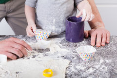 Dad and son baking cookies Royalty Free Stock Photography