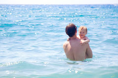 Dad and son bathing Stock Image