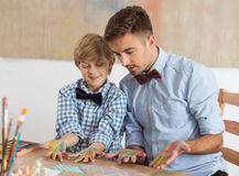 Dad and son. With bow ties and dirty hands Stock Photo
