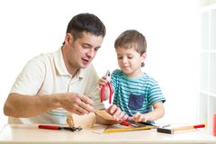 Dad and son child working with tools together Royalty Free Stock Image