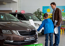 Dad and son choose a new car Royalty Free Stock Photo