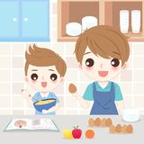 Dad and son cooking. In the kitchen Royalty Free Stock Photos