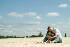 Dad with son. Playing in the sand stock photography