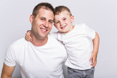 Dad with son. A Dad with son in the studio white background royalty free stock images