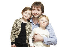 Dad, son and daughter family group smiling Royalty Free Stock Photography