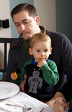 Dad and Son At Dinner Table Royalty Free Stock Photo