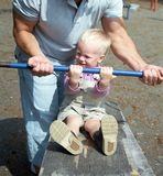 Dad and  son do exercises Royalty Free Stock Image