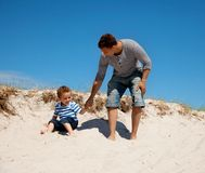 Dad and Son Enjoying and Having Fun. On a sunny summer day Royalty Free Stock Photo