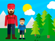 Dad and son on family trip in the forest Royalty Free Stock Image