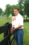 Dad and Son on Farm. Father and Son together on family farm Royalty Free Stock Image
