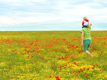Dad and son in the field. Dad with his son on the poppy field Royalty Free Stock Image