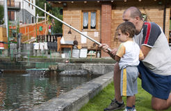 Dad and son fishing stock photos