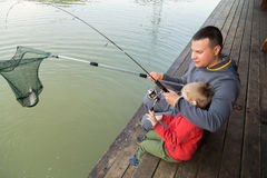 Dad and son on fishing Stock Photo