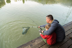 Dad and son on fishing. Family weekend leisure. Family fishing at the lake Royalty Free Stock Images