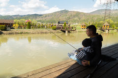 Dad and son on fishing Royalty Free Stock Image