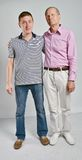 Dad and son on grey background Stock Photography