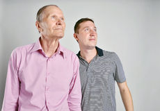 Dad and son on grey background Stock Images