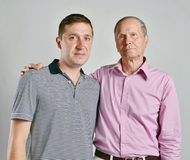 Dad and son on grey background Royalty Free Stock Photography