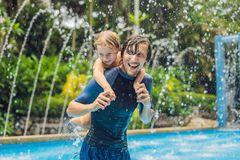 Dad and son have fun in the pool.  stock photos