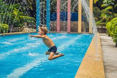 Dad and son have fun in the pool.  royalty free stock photos